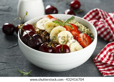 Breakfast bowl with fruits, seeds and berries - stock photo