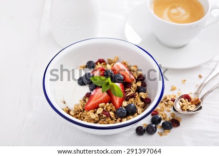 Breakfast bowl with homemade granola and yogurt - stock photo