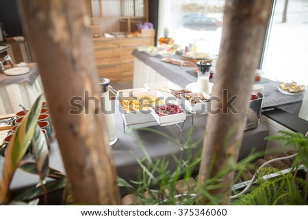 Breakfast buffet.Served for breakfast.Self-service all you can eat buffet.Hotel,canteen breakfast.Healthy breakfast with whole grain cereals,berries,toast bread,jam and butter. - stock photo