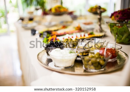Breakfast buffet with mediterranean dips and topping, side dish. Olives and cream served for breakfast.Self-service breakfast all you can eat buffet.Hotel,canteen breakfast - stock photo