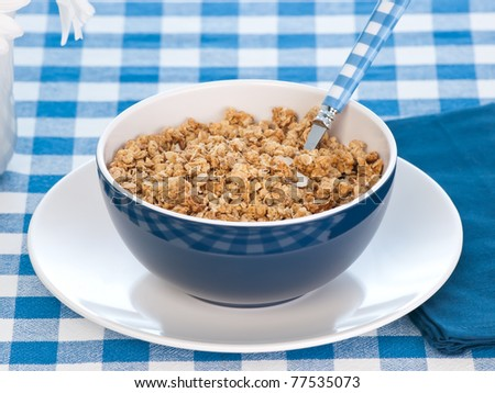 Breakfast cereal  on the  table with milk and flowers - stock photo
