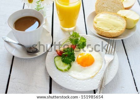 Breakfast: coffee and fried egg  - stock photo