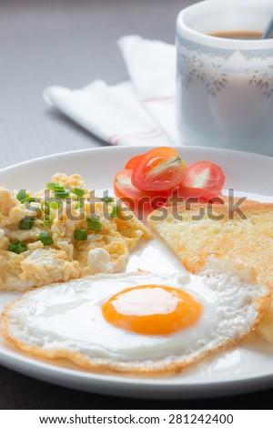 Breakfast coffee, fresh fried egg and scrambled egg - stock photo