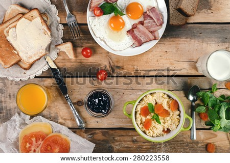 Breakfast composition for country family in the morning. Horizontal top view - stock photo