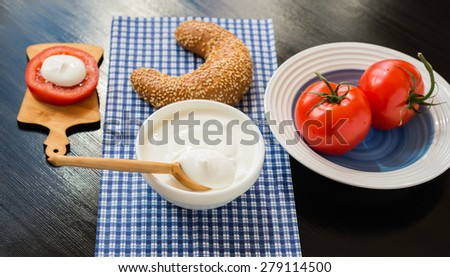 Breakfast. Cream Cheese, Tomatoes and Grain Bagel  - stock photo