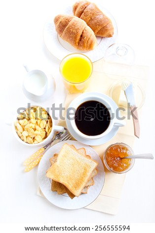Breakfast: croissants, toasts, orange juice and coffee - stock photo