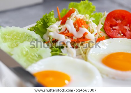 Breakfast, eggs and vegetables.