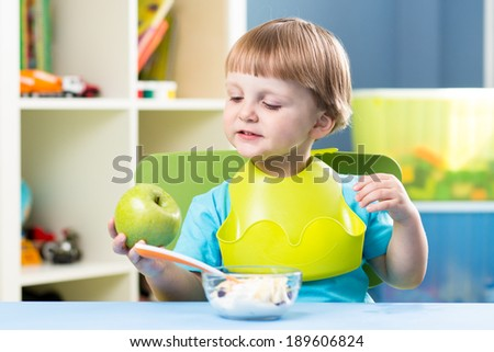 Breakfast for kid boy. Baby eating healthy food. - stock photo