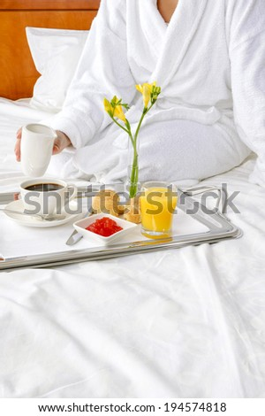 Breakfast in bed at hotel room - stock photo