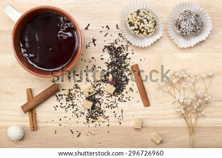 Breakfast in bed.Black tea and delicious cake - stock photo