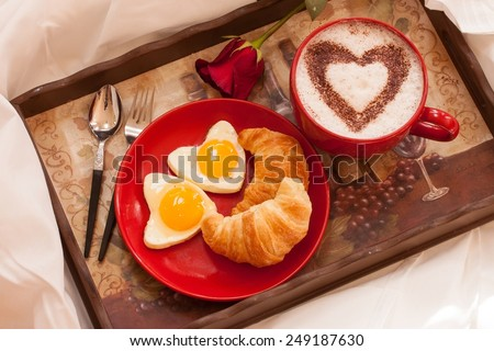 Breakfast in bed - eggs and croissants with a cup of coffee - stock photo