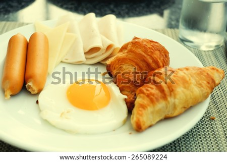 breakfast in morning focus on egg.vintage style picture - stock photo