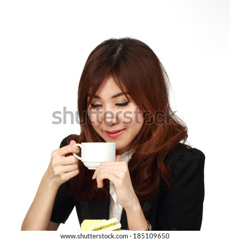 Breakfast in office / Woman having breakfast in office - stock photo