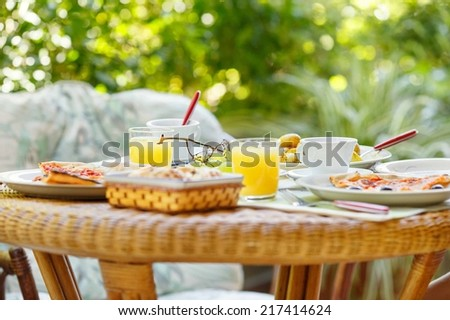 Breakfast in the garden - stock photo