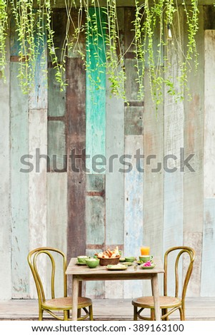 Breakfast in the garden with coffee and a simple food. Good mood for all day. - stock photo