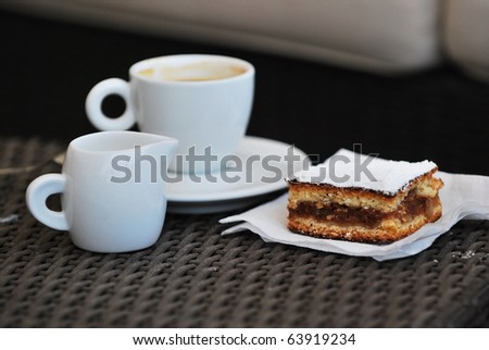 Breakfast in the morning - cofee with milk and cake - stock photo