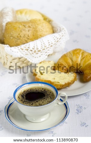 Breakfast items displayed on a white tablecloth - stock photo