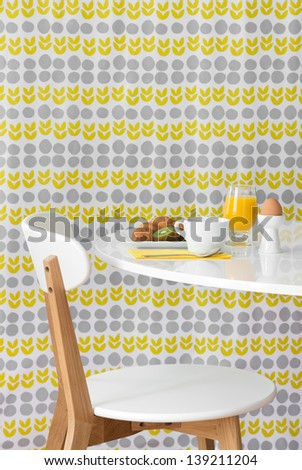 Breakfast. Modern table and chair on bright floral background. - stock photo