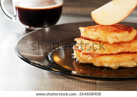 Breakfast of apple pancakes with honey - stock photo