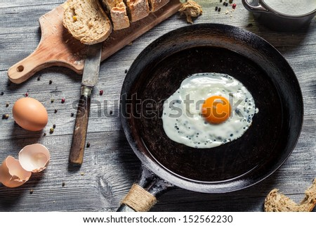 Breakfast of eggs and bread - stock photo