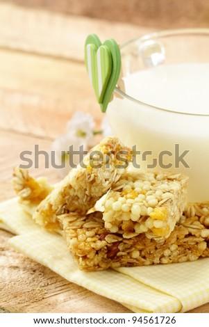 breakfast of muesli bars and milk - stock photo