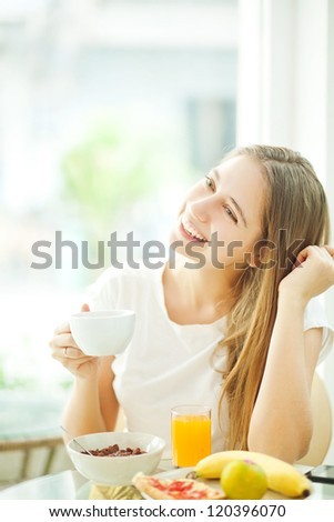 Breakfast of young people (soft focus) - stock photo