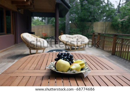 Breakfast on fresh air at the hotel - stock photo