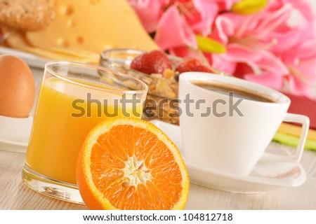 Breakfast on the table. Coffee, orange juice, rolls, muesli. - stock photo