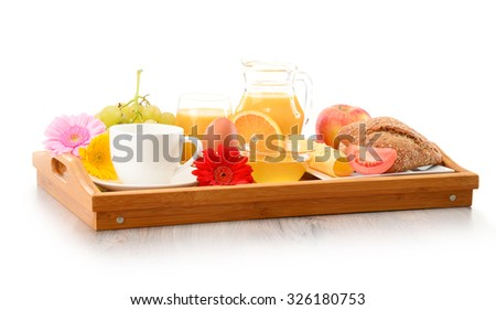 Breakfast on tray served with coffee, orange juice, egg, rolls and honey. Balanced diet.