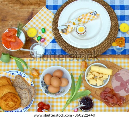 breakfast or brunch table setting  full of healthy ingredients for a delicious easter meal with friends and family around the table  - stock photo