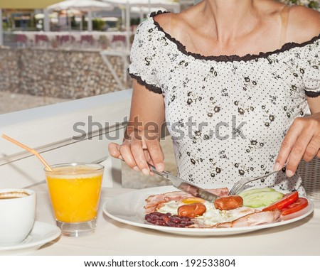 Breakfast outside at the hotel restaurant - stock photo