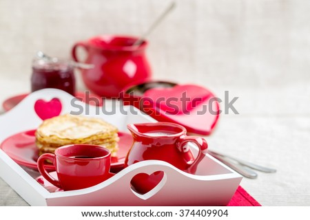 Breakfast. Pancakes and coffee with milk on a tray for Valentine's day. Selective focus. - stock photo