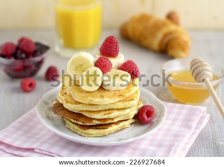 Breakfast pancakes with banana and coconut - stock photo