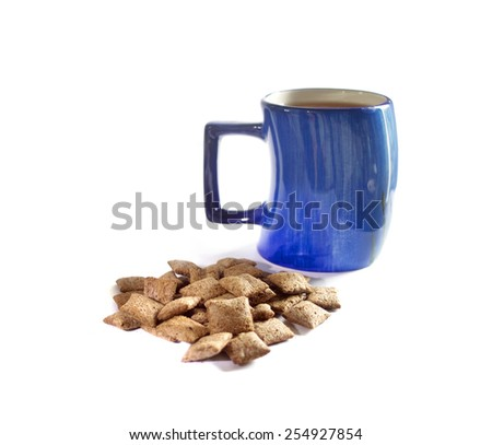 Breakfast pillows cereals and tea on white - stock photo