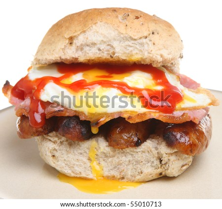 Breakfast roll with tomato ketchup. - stock photo