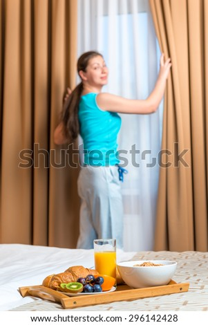 Breakfast room service and a portrait of a happy women awakened - stock photo