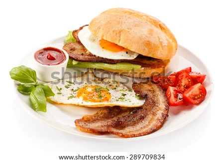 Breakfast - sandwich, egg, bacon and vegetables  - stock photo