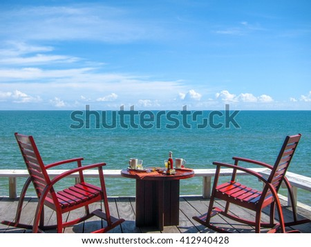 Breakfast serves on the balcony right on the beach in a beautiful morning