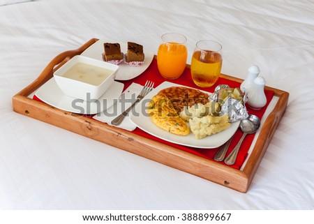 breakfast beanorange juicemilk and sweat in wooden