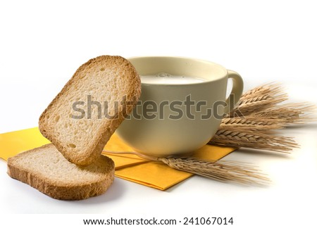 breakfast set with milk and rusks - stock photo