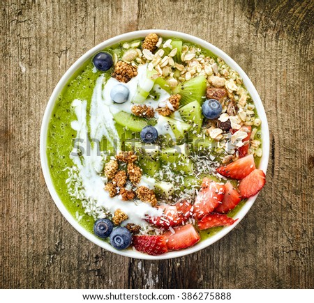 breakfast smoothie bowl topped with fruits and berries - stock photo