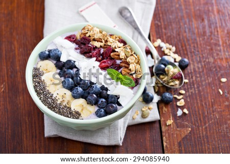 Breakfast smoothie bowl with fruits and granola - stock photo