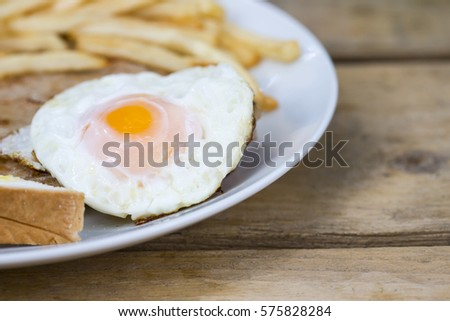 breakfast stack with fried egg and bread french fried