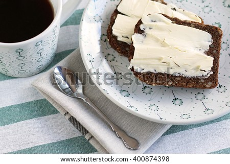 Breakfast time. Coffee with toasts with butter - stock photo