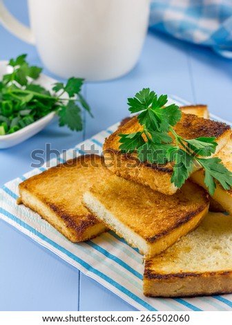 Breakfast toasts with verdure and cup of coffee