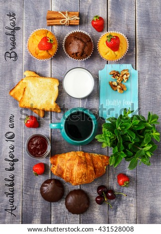 Breakfast Top View. Coffee, Berries and Sweet Cakes on Wooden Background. Rustic Cover Menu. - stock photo