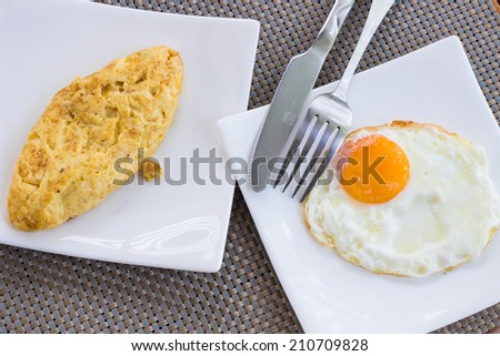 Breakfast two eggs in two plates.