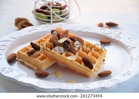 breakfast waffles with almonds - stock photo
