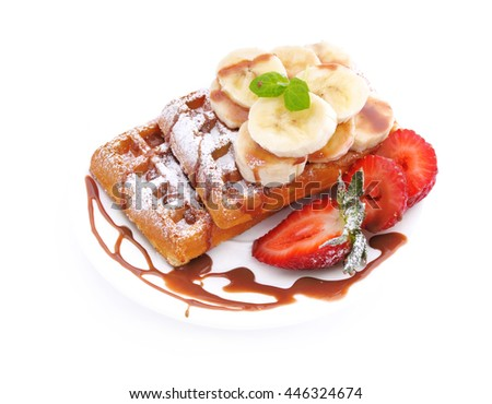 Breakfast.Waffles with banana slices and strawberries. - stock photo