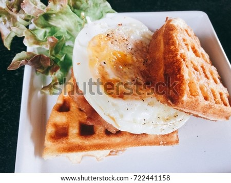 Breakfast Waffles with Eggs in White Plate